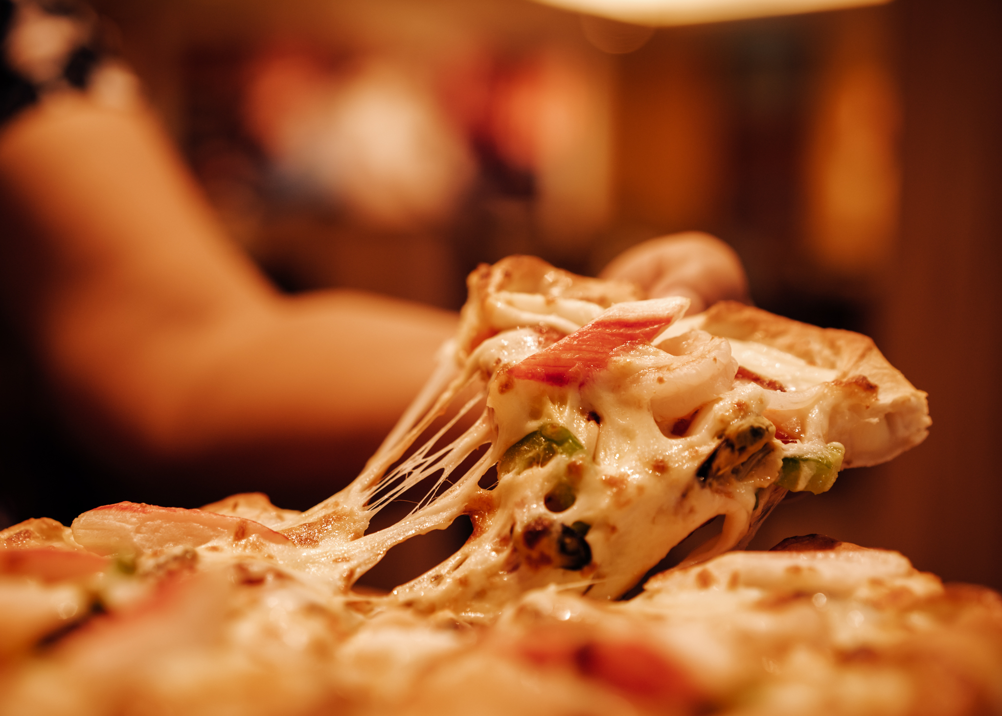 Slice of hot pizza cheese lunch or dinner crust seafood meat top