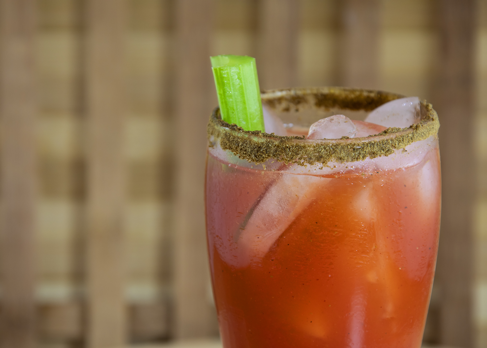 Half glass of a Canadian caesar cocktail